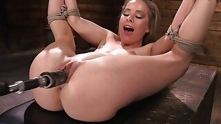 Fucking machine drills pussy of chick with tied up hands and legs