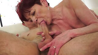 Redhead granny that loves young cock gives us a good show