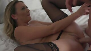 Lovely blonde in stockings is riding big cock on the couch