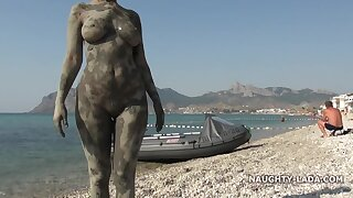 Naughty & Dirty MILF exhibitionist in mud pool on the public beach