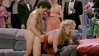 Retro people are watching horny couple fucking hard at party
