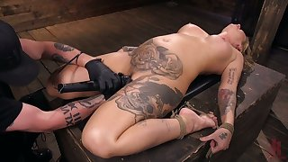 Tattooed porn model Kleio Valentien gets punished in the dark BDSM room