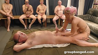 Blonde whore pleases nude men with erotic massage